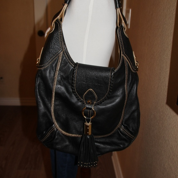 Large Oryany Black Leather with Tassel Purse. M 5a651fe333162706c4b9a8bf b2f0ea6af3a3d